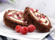 chocolate honey roll with raspberries